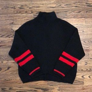 Black knit turtleneck with red stripes